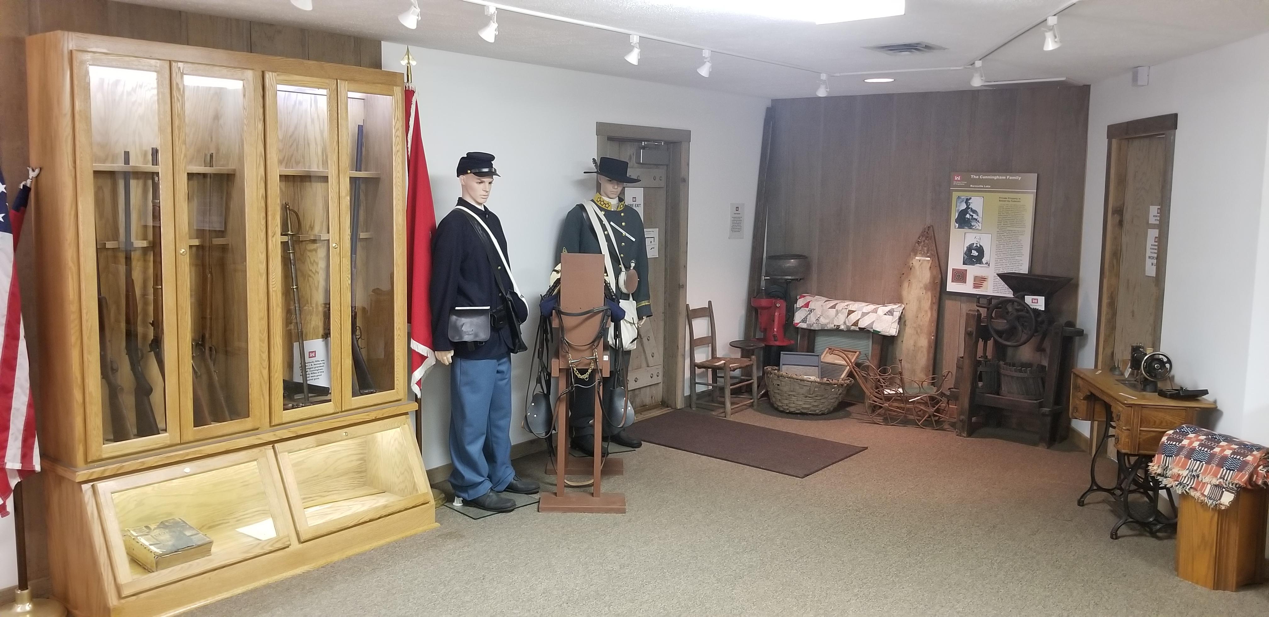 Federal Private's Uniform (Left) & Confederate Colonel's Uniform (Right)