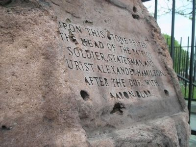 Close-up photograph of the inscription on the rock.