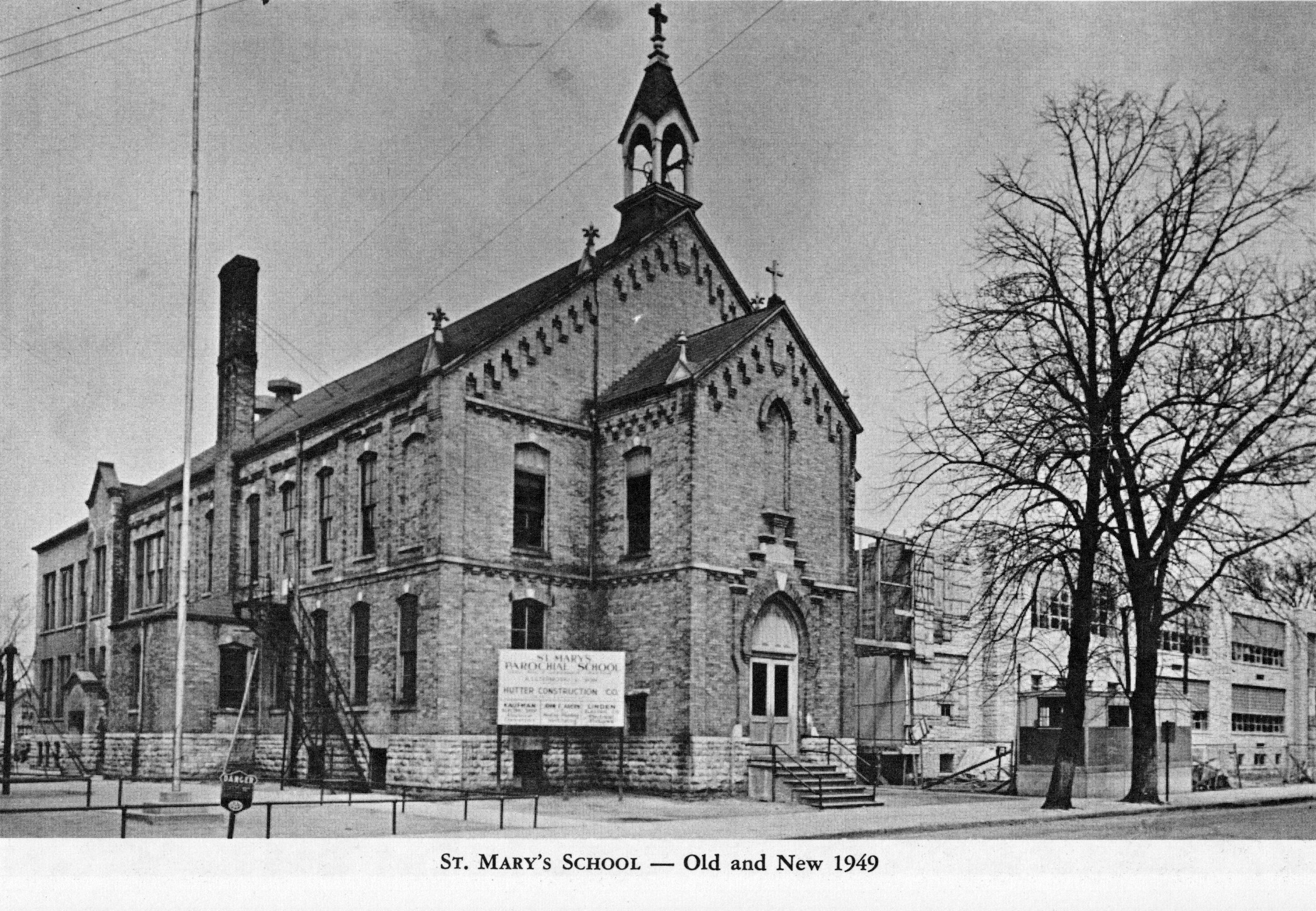 Old St. Mary's School with the new school building in the background, 1949.