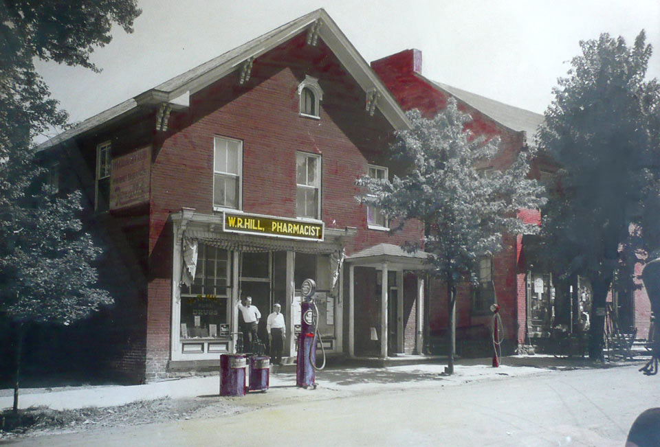 WR Hill Pharmacy in early 1920s. Bernard W. Hill is standing to the left of Walter Reynolds Hill, his father.  Collection of BW Hill Insurance Agency.