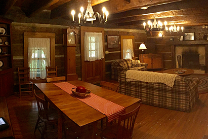 The inn contains four bedrooms, four and a half bathrooms, three porches, a full-sized kitchen, and a washer and dryer.