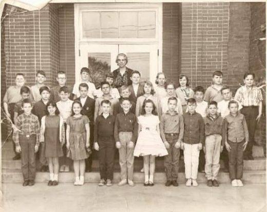 Class photo outside Ensign Elementary, circa 1960s