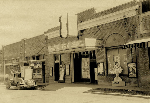 This historic image shows the Rex Theater in the 1920s