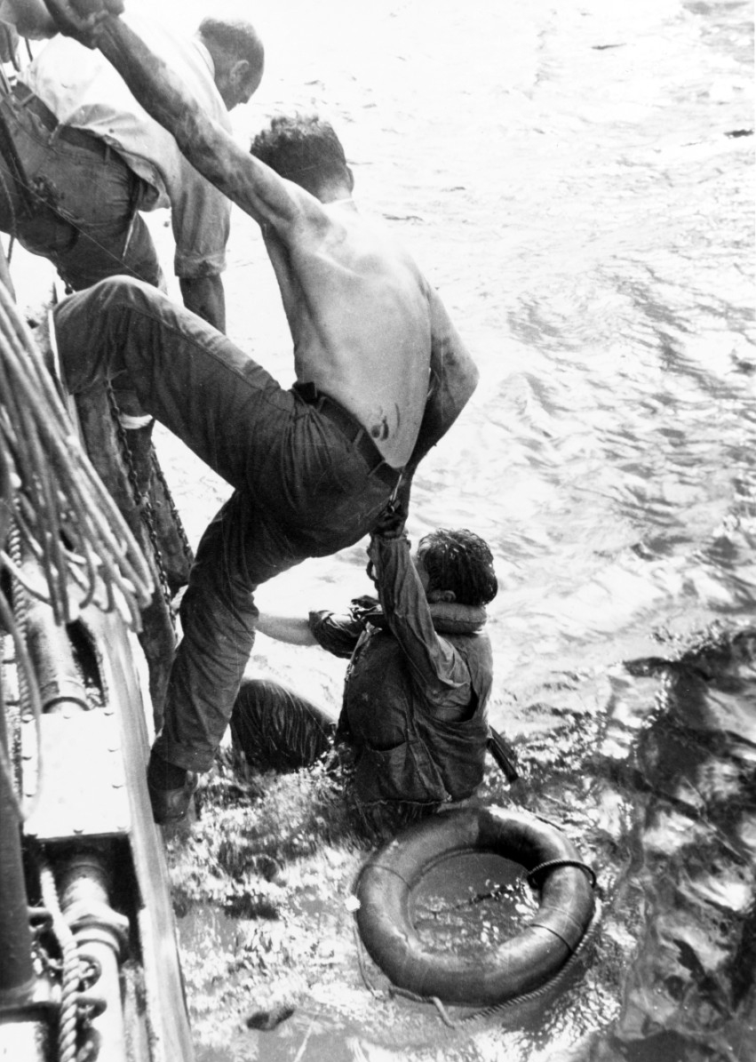 Survivors from the battle are pulled from the water by Naval personal. Approximately 1,200 survivors from Johnston, Hoel, Gambier Bay, and Samuel B. Roberts were rescued.