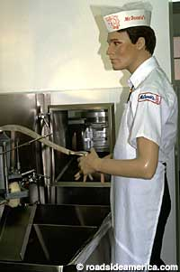 A McDonald's employee mannequin making french fries.