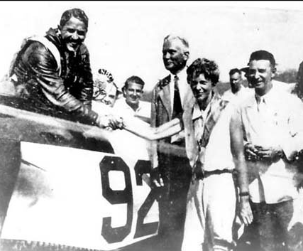 After winning the Bendix Trophy, 1932. - L to R: James Haizlip, Herlam Bingham (the discoverer of Machu Picchu, and at the time a senator) Amelia Earhart, Cliff Henderson, managing director of the National Air Races. Flying the Wedell-Williams '92'.