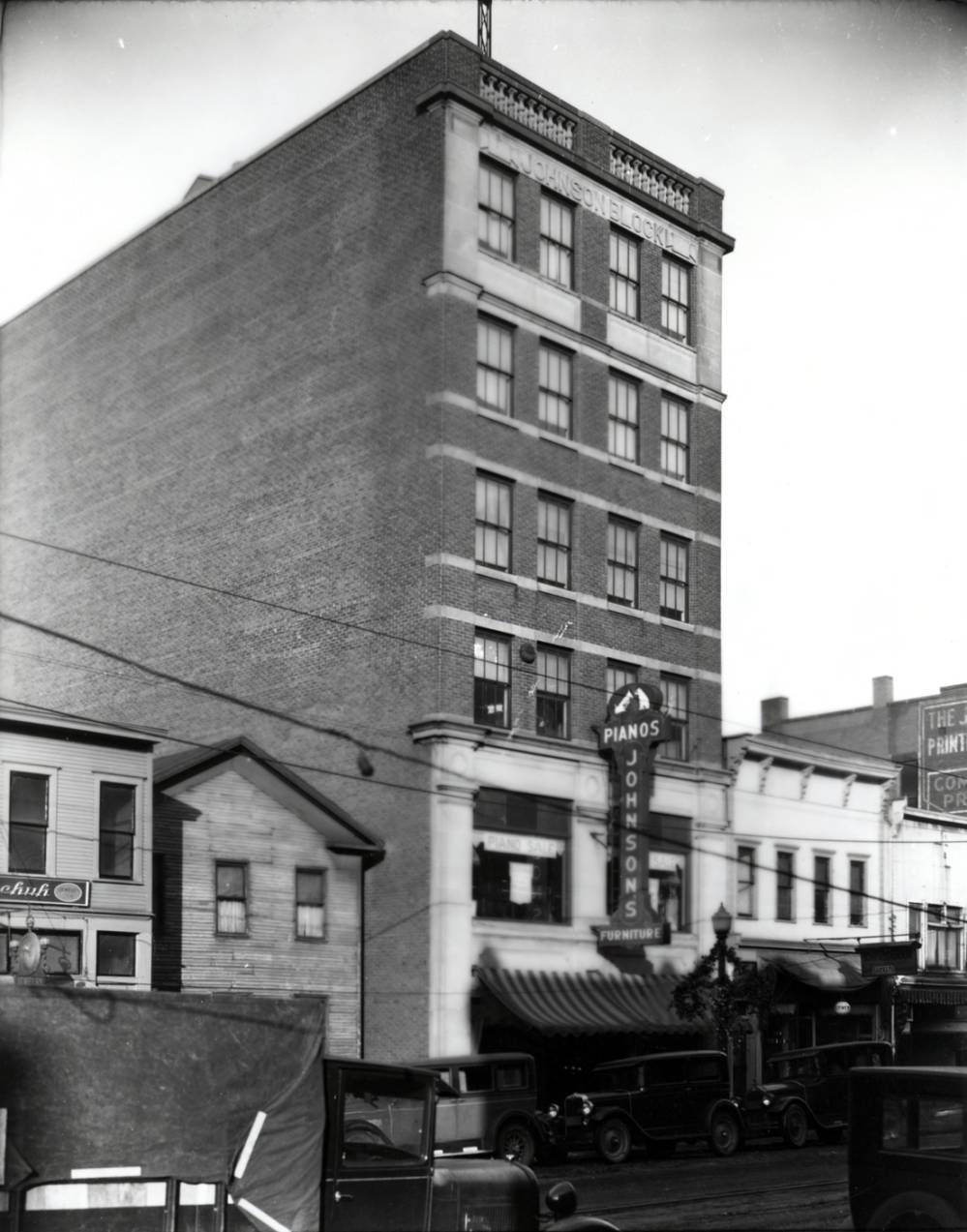 In the 1920s and 1930s, two other buildings occupied the space where the Alliance Area Chamber of Commerce is today at 210 E. Main Street, as seen in this 1929 photograph.