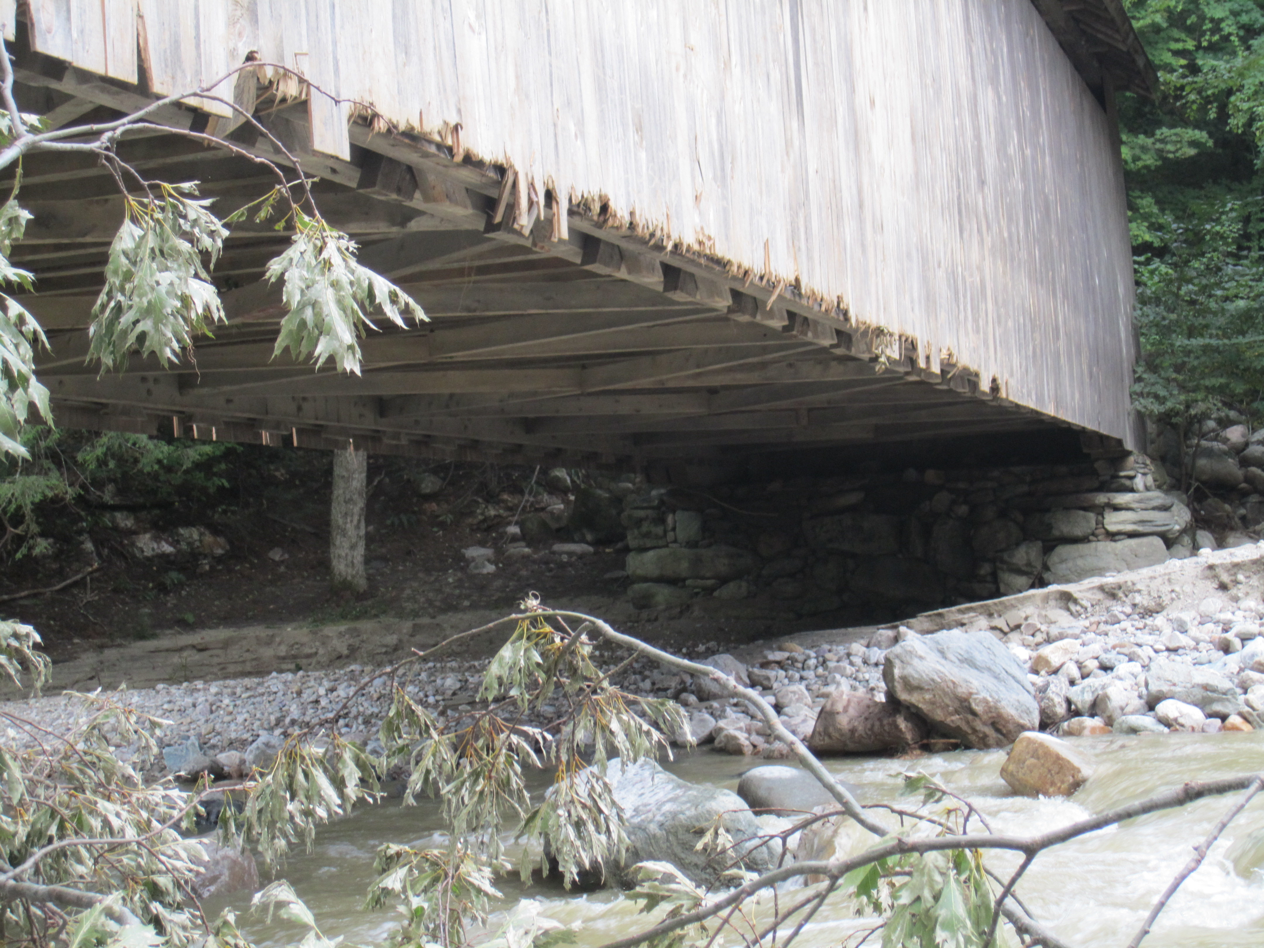 The underside of the bridge where some of the damage from flooding in 2011 is visible prior to being repaired.