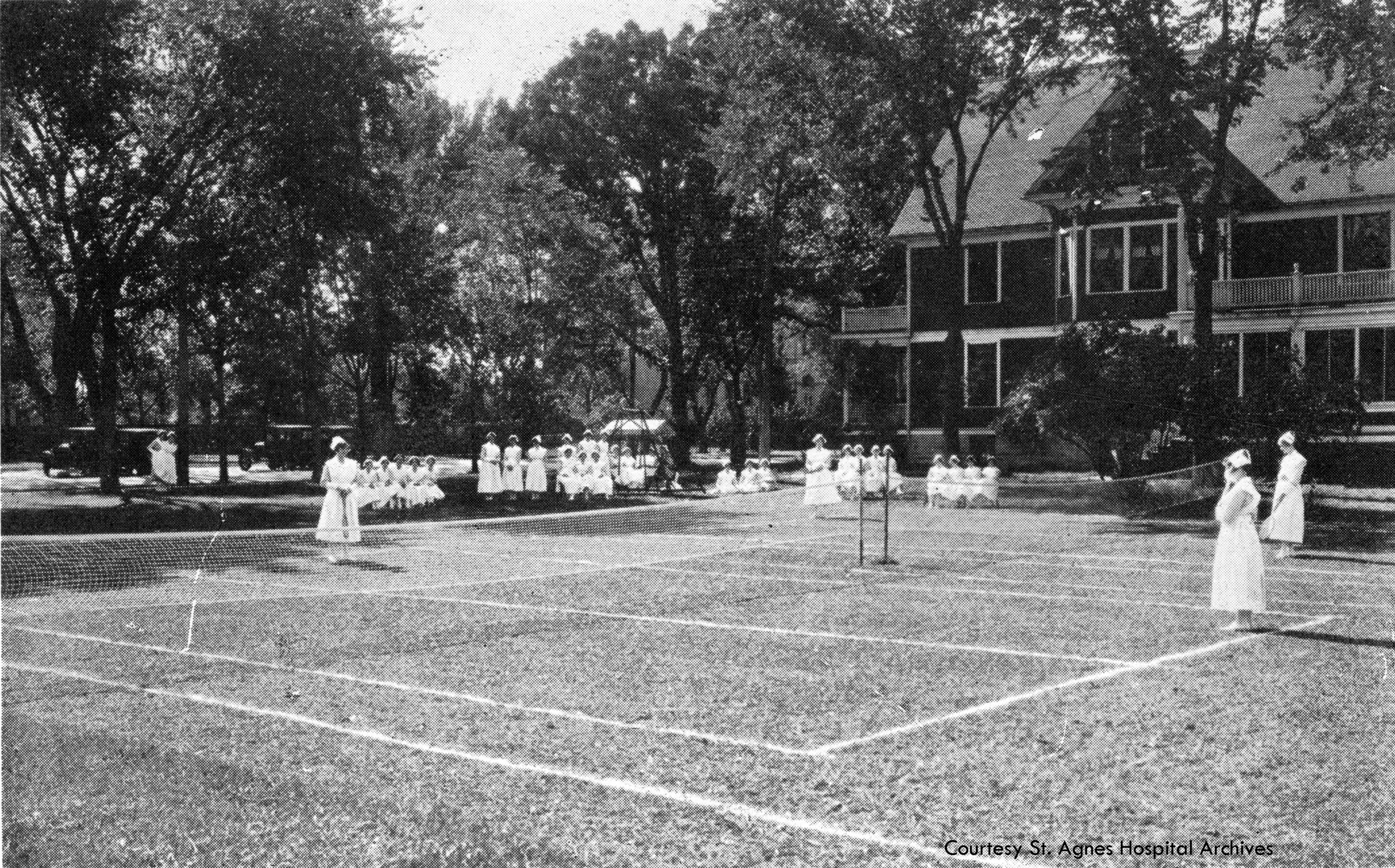 Student nurses play tennis during some recreation time, c. 1925.
