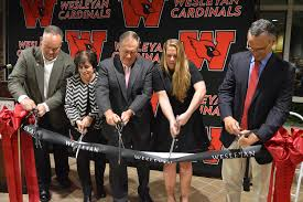 Bill Belichick cutting the ribbon at the ceremony where Belichick Plaza was introduced