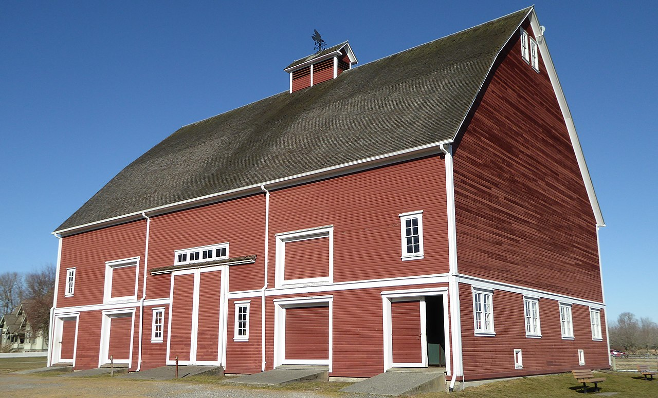 The Hovander Barn is quite large at 95-feet long and 65-feet long. It houses original farm equipment and tools.