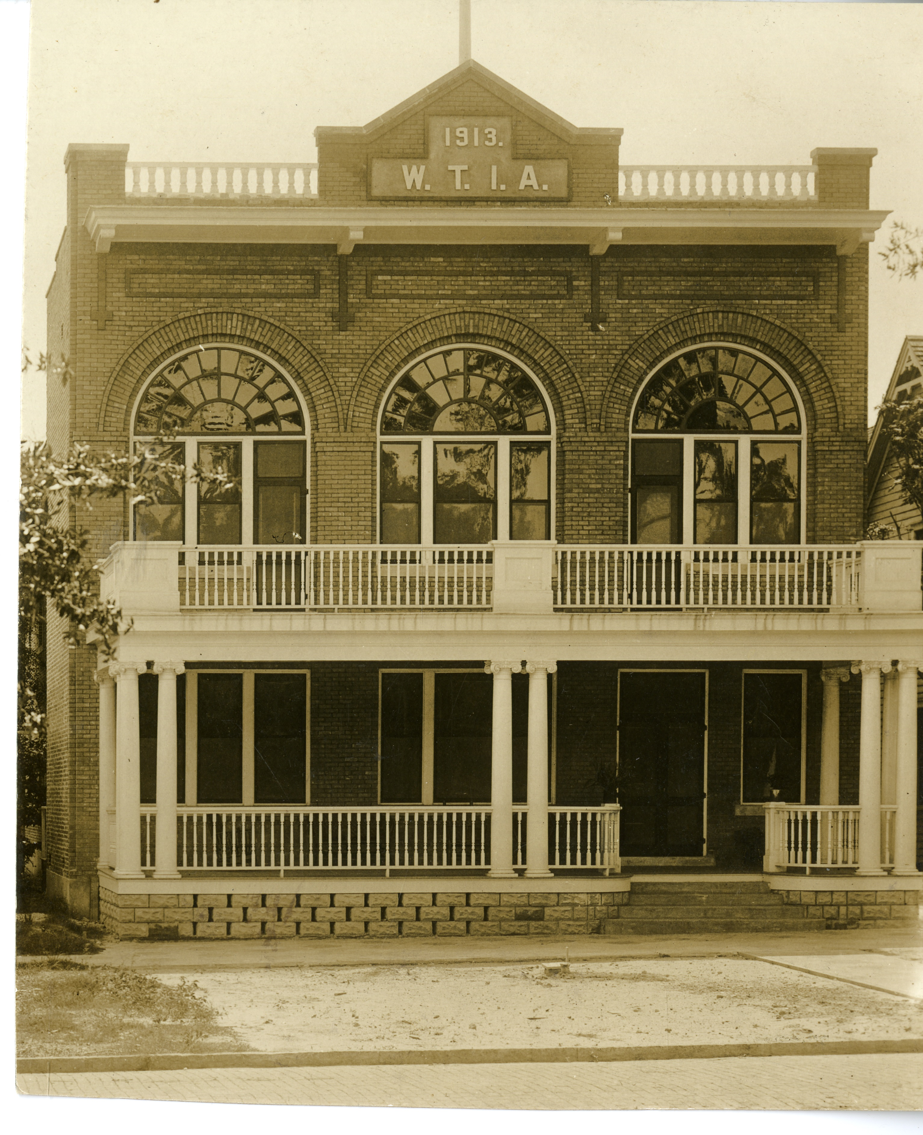 Headquarters of the St. Petersburg Women's Town Improvement Association in downtown St. Petersburg, circa 1913. This building no longer exists. The WTIA was founded in 1901 and first met in the Detroit Hotel. Sarah Armistead, the widow of John C. Williams, was an early member of the WTIA. The WTIA continued the work of the Park Improvement Association, who were responsible for building the bandstand, in beautifying Williams Park.