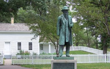 A statue of John H. Stevens in front of the house