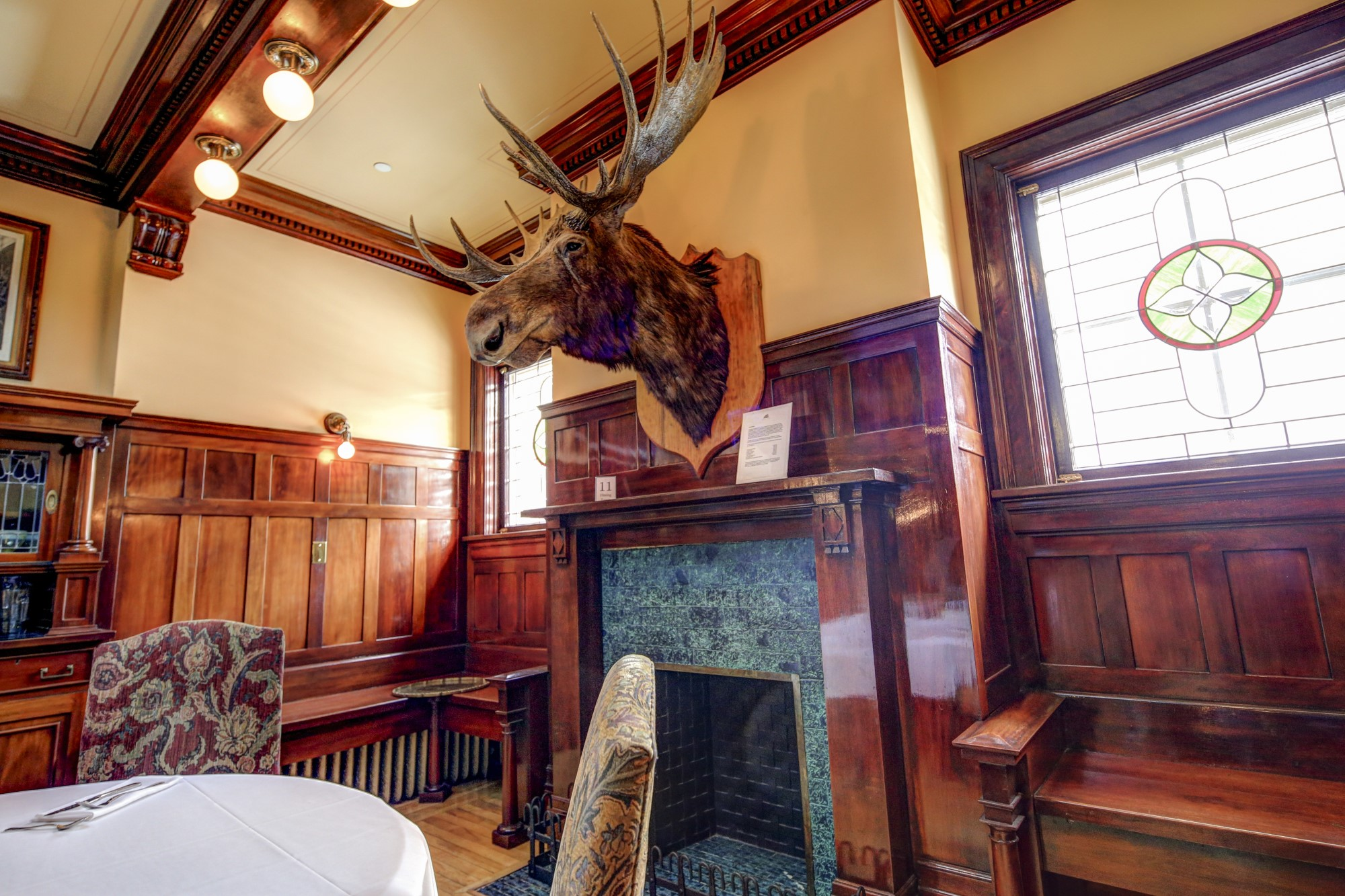 Image 3, Dining Room fireplace with taxidermy moose