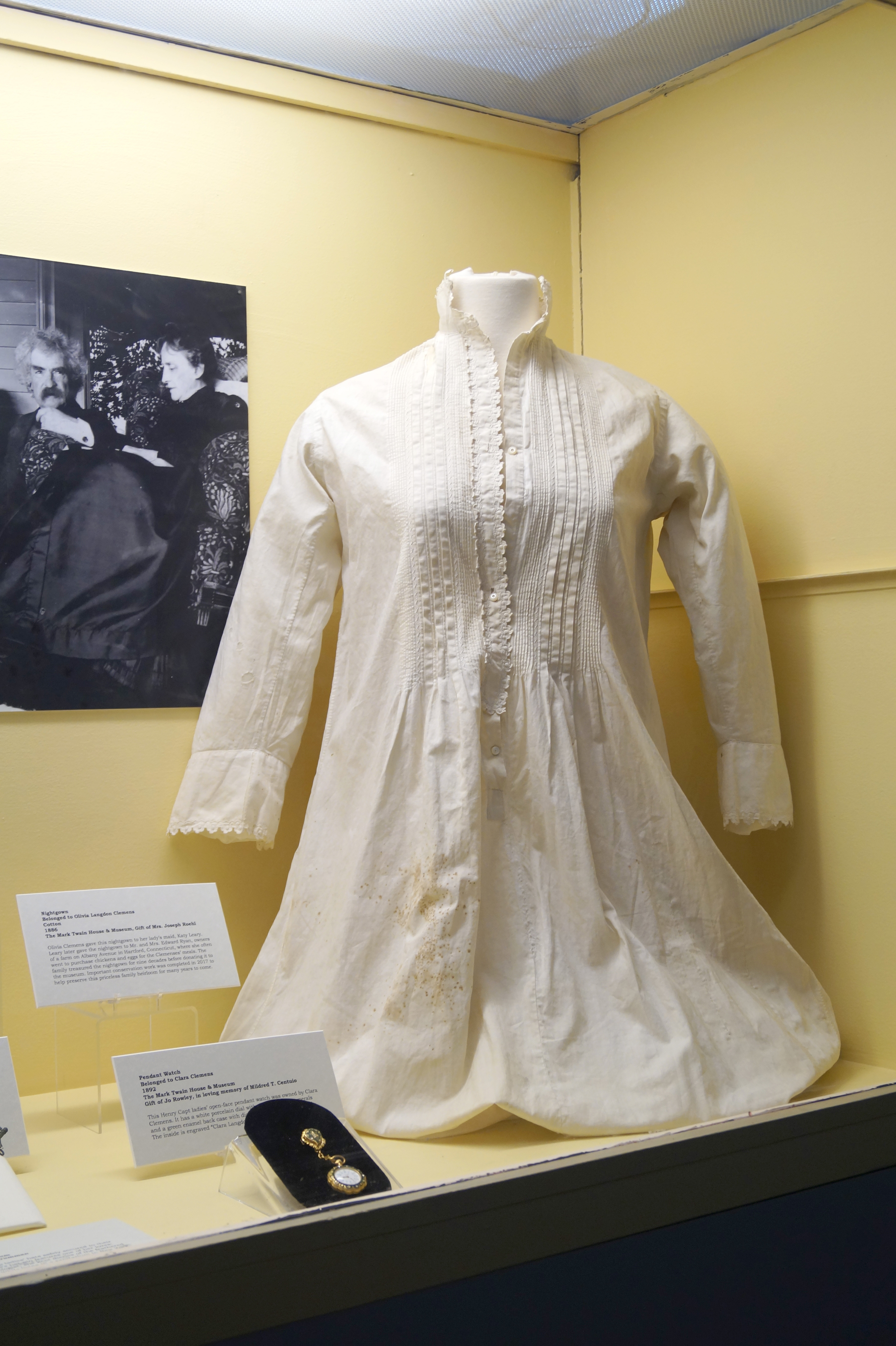 Olivia Clements gave this nightgown to her lady's maid, Katy Leary.  Leary later gave the nightgown to Mr. and Mrs. Edward Ryan, owners of a farm on Albany Avenue in Hartford, Connecticut, where she often went to purchase chickens and eggs for the Clemenses' meals.  The family treasured the nightgown for nine decades before donating it to the museum.  Important conservation work was completed in 2017 to help preserve this priceless family heirloom for many years to come.