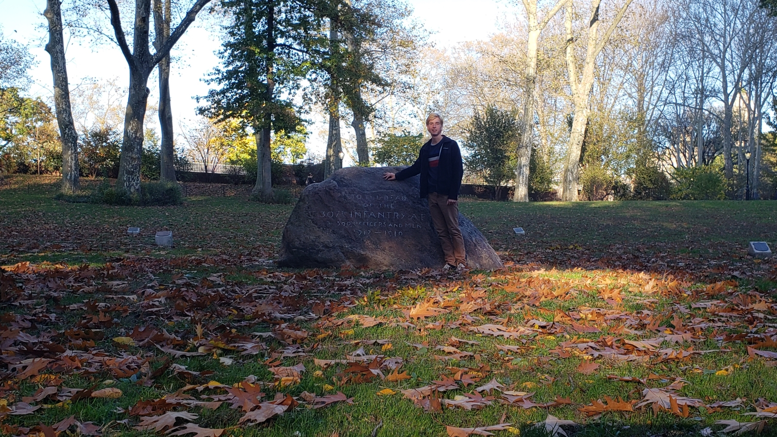 The grove's memorial boulder with a person for scale