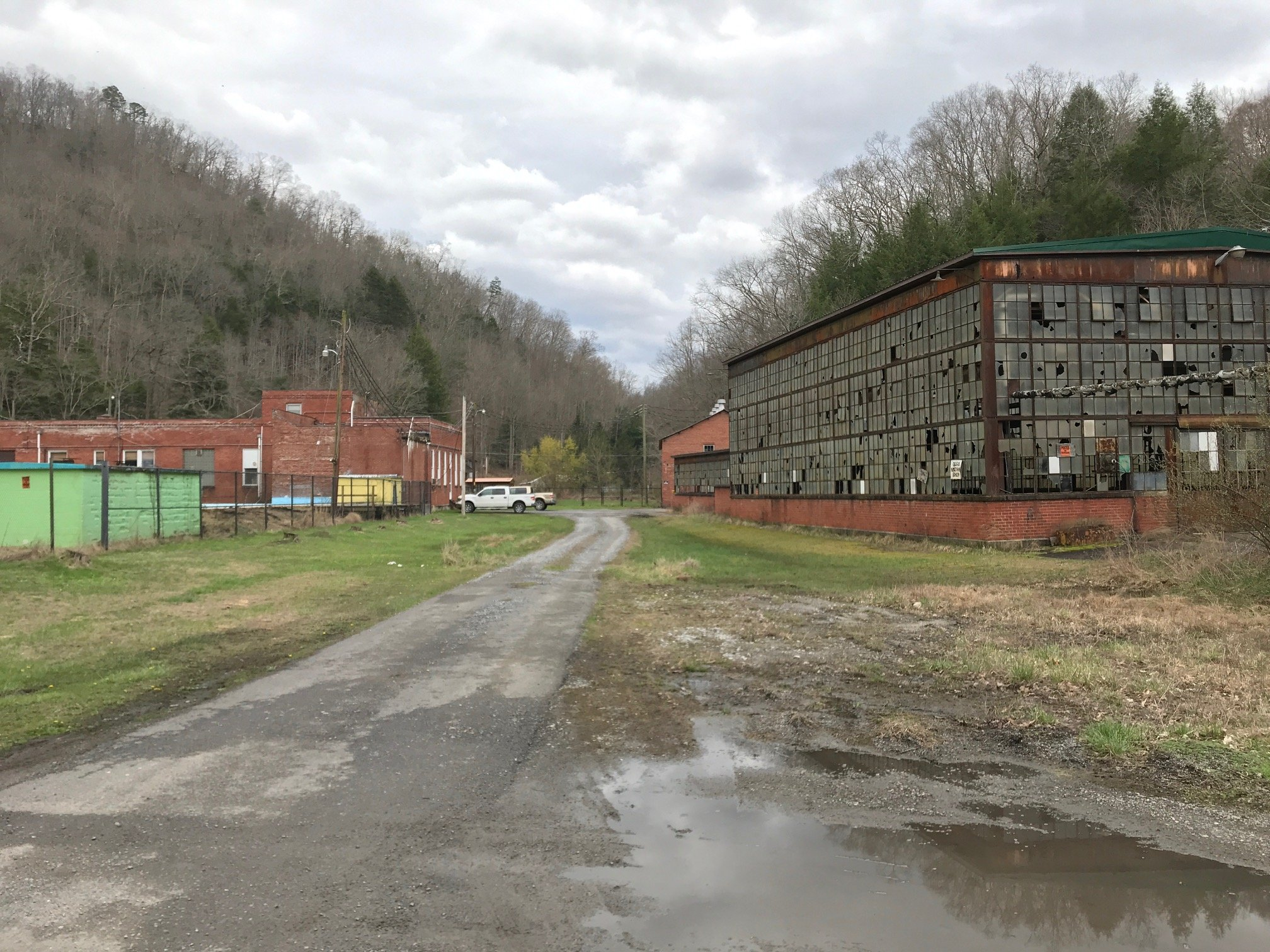 Former site of the big store on the left (demolished), and the machine shop on the right.