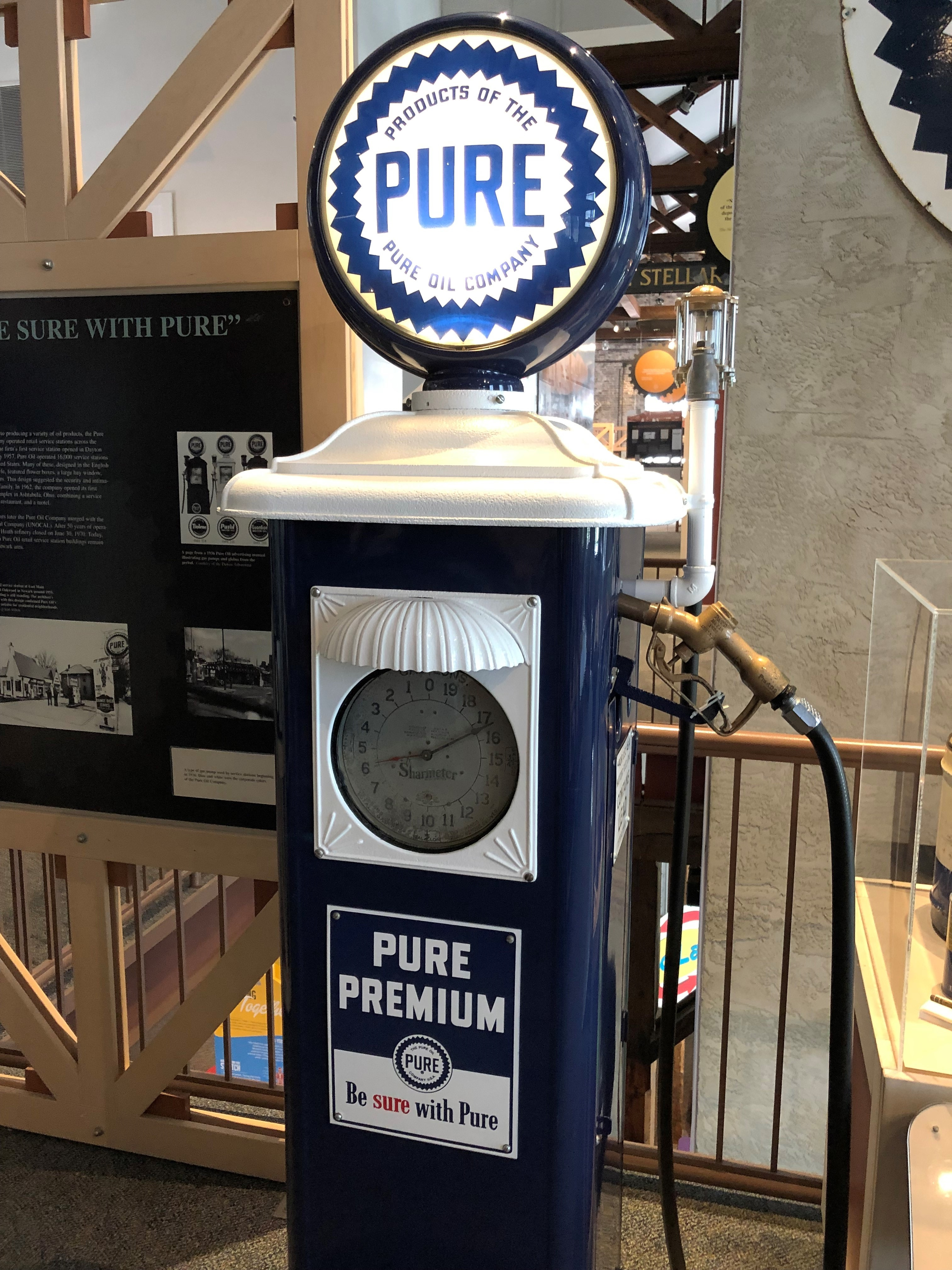 This style of gas pump was used by service stations beginning in 1936. The blue and white colors make it easily recognizable as a Pure pump.