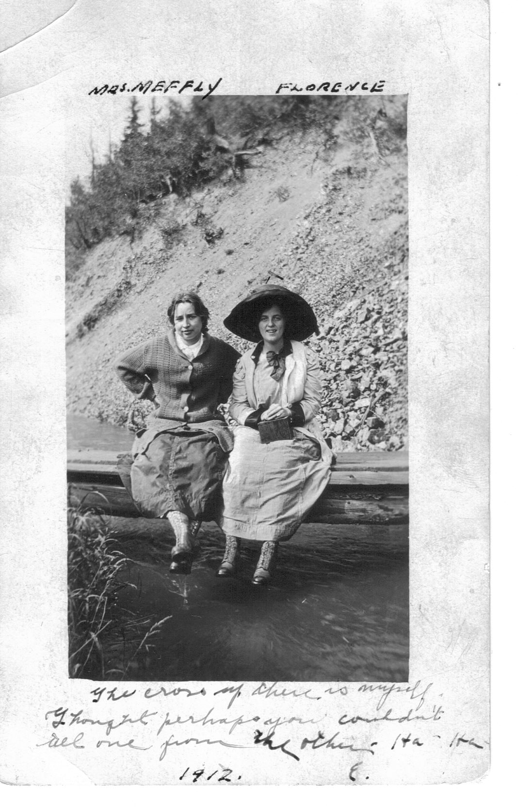 A picture-turned-postcard from 1912 addressed to Mr. Carl Hedenskog in La Junta, Colorado. The women are self-identified as Mrs. Meffly and Florence [Hedenskog]. Notice the large hat and the lace-up, close-toed shoes.