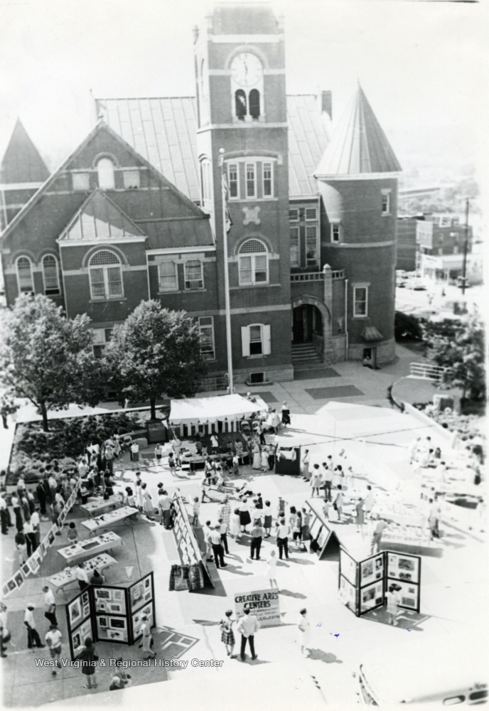 "Photo of a ""Creative Arts Exhibit"" held in the courthouse plaza in 1966."