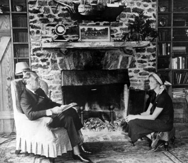 Governor Franklin D. Roosevelt and his daughter Anna in the living room of his newly-built home, the Little White House