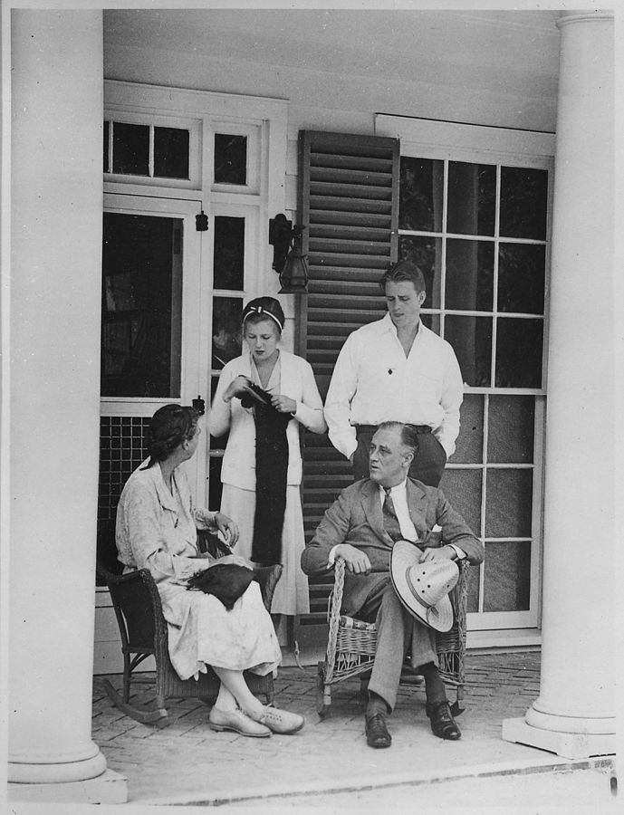 """Eleanor Roosevelt, FDR, their son Elliott, and his wife Elizabeth """"Betty"""" on the porch of the Little White House in 1932"""