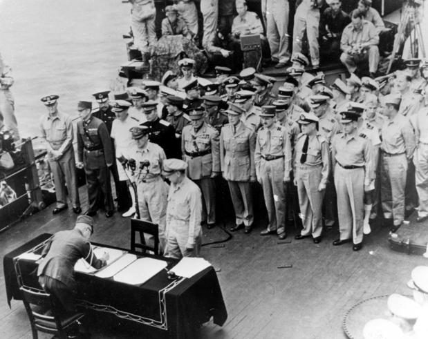 The Japanese delegation prepare to sign the official documents ending World War II before U.S. general Douglas MacArthur