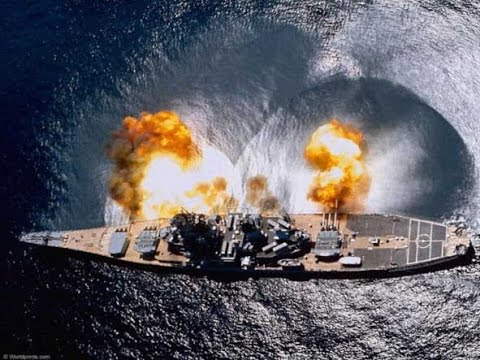 Photo of the USS Missouri firing a full broadside