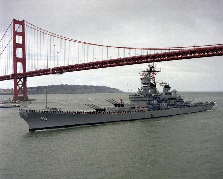The USS Missouri sails under the Golden Gate Bridge.