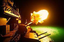 The USS Missouri firing her guns at night