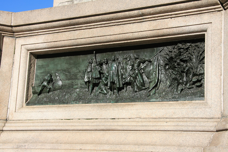 Christopher Columbus voyage scene represented via bas relief at the base of the memorial