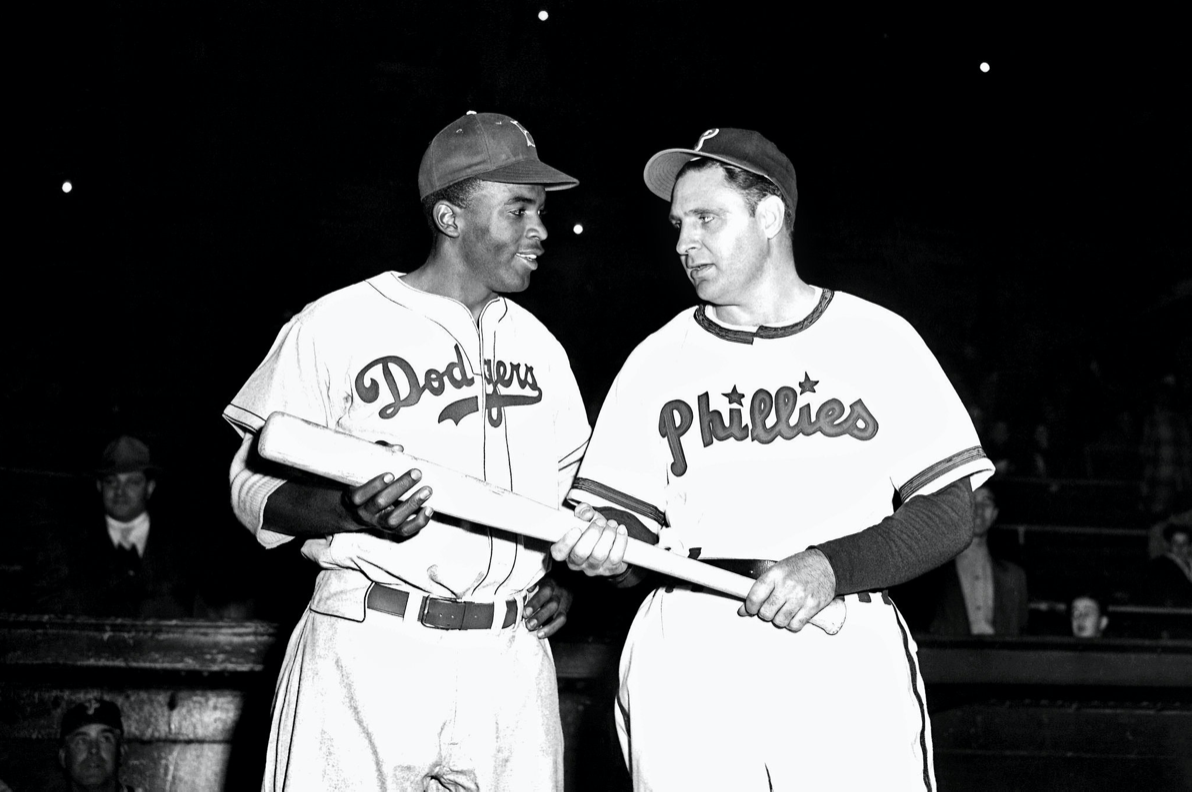 Ben Chapman and Jackie Robinson posing together after Chapman's bench jockeying. This picture was taken to show that the two men were friends despite the racist behavior displayed by Chapman.