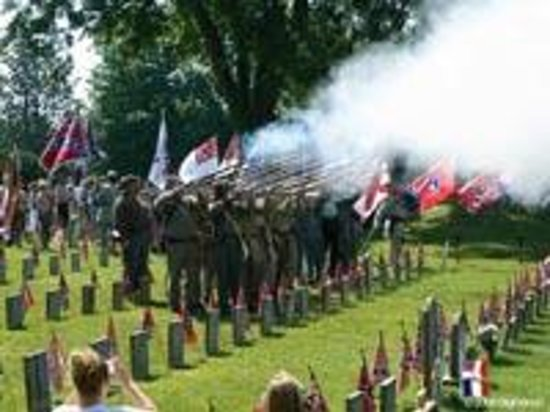 Reenactors fire a salute during a Confederate Memorial Day event