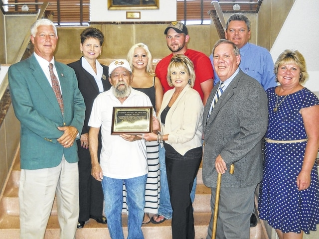 Sculptor Bob Roach being honored in 2013 by the Mason County Commission for his stainless steel art pieces depicting the history of Mason County, WV.