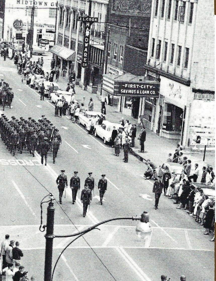 The former theater's marquee was used by First City Savings & Loan, pictured during a 1962 parade