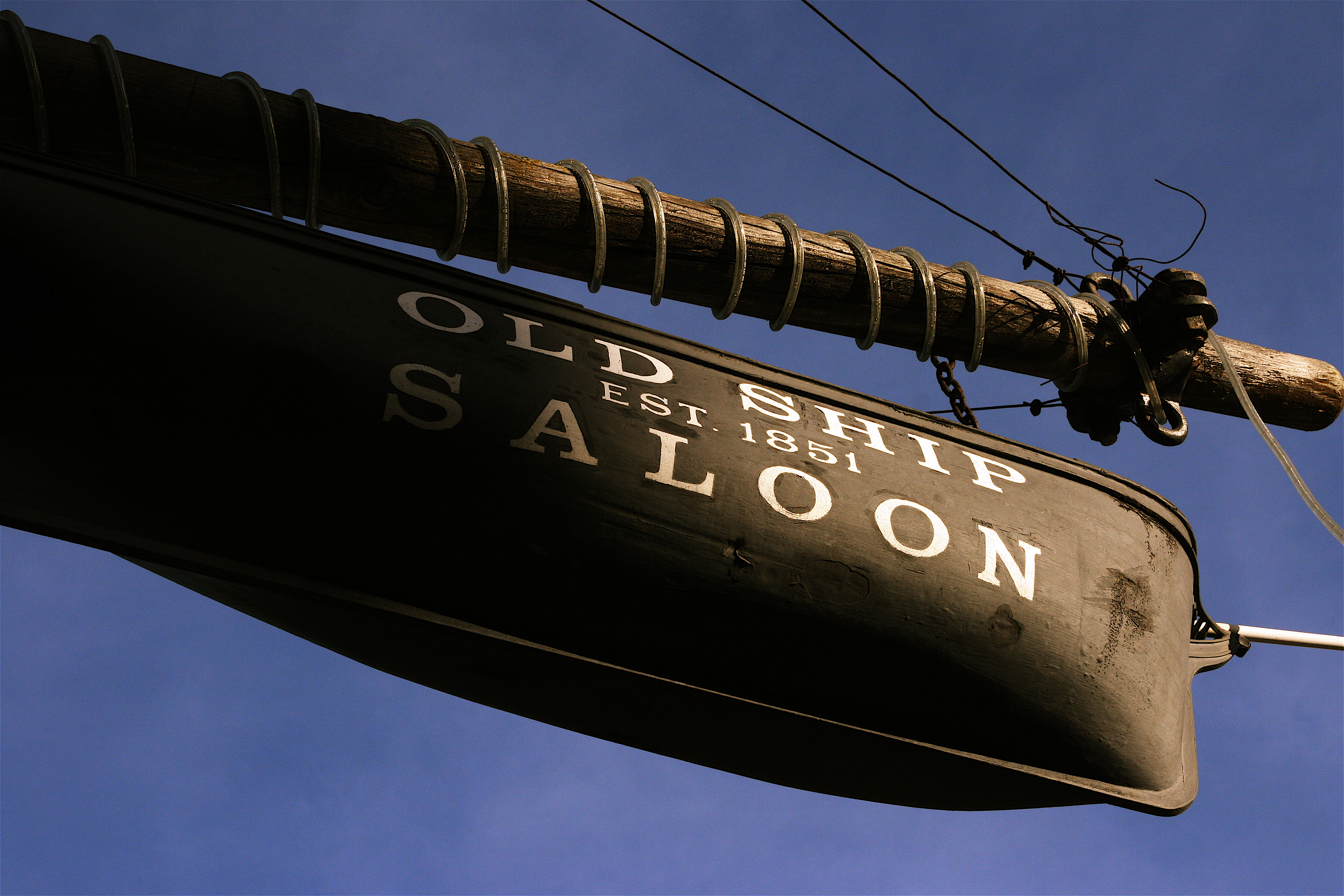 The Old Ship Saloon (built in 1851) was originally opened in the hull of a sailing ship, the Arkansas. The hull of this ship is now buried below paved city streets, but the saloon still operates in at street level in a building at the same spot