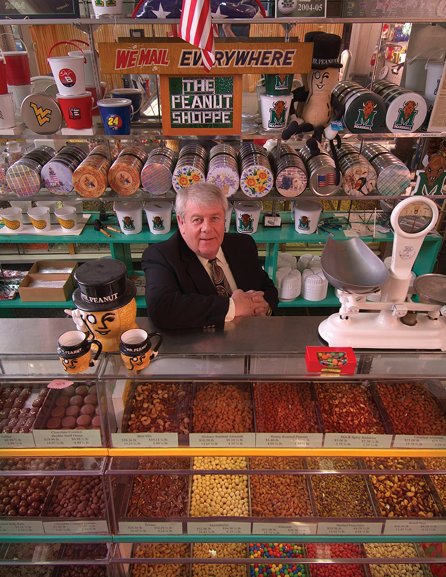 Former owner Doug Myers behind the counter of The Peanut Shoppe