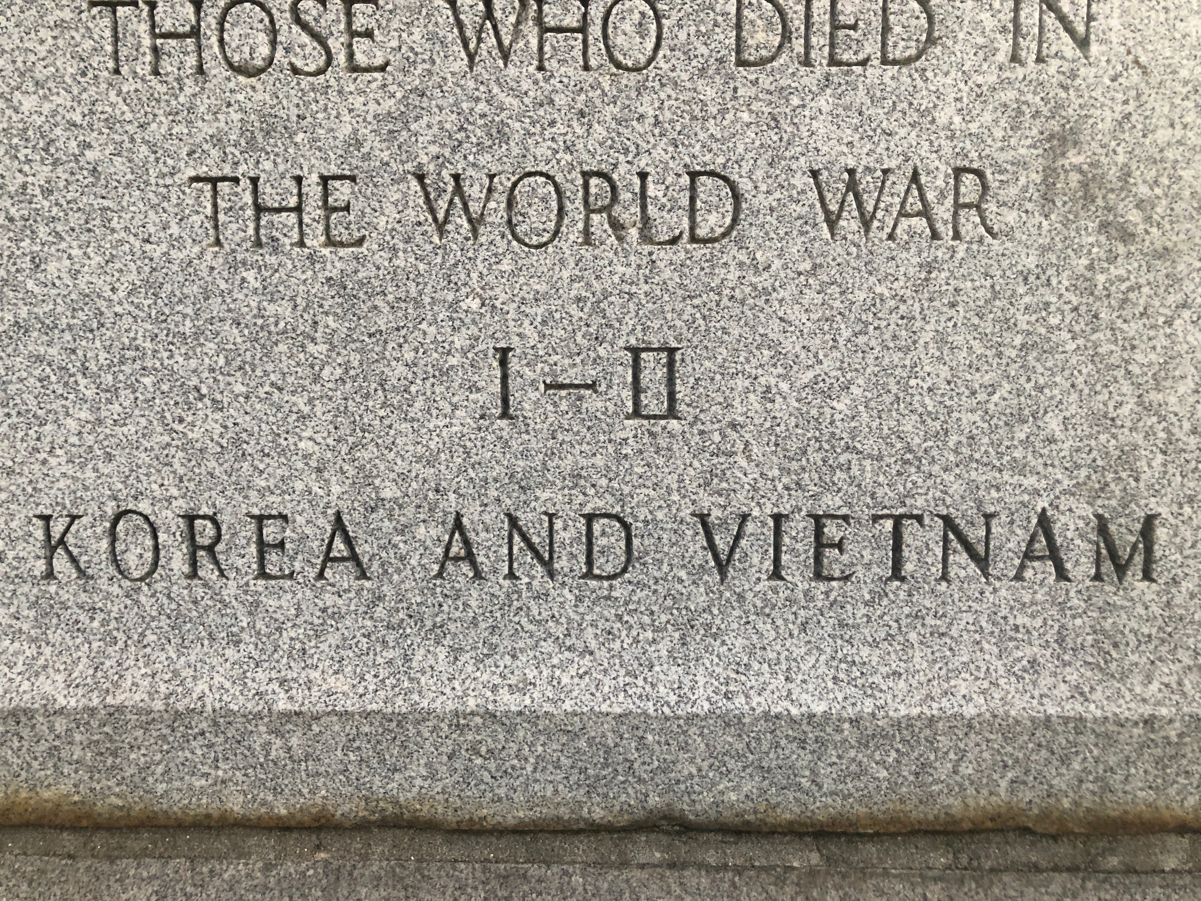 Close-up upon the last two lines of the original inscription and the newer inscription