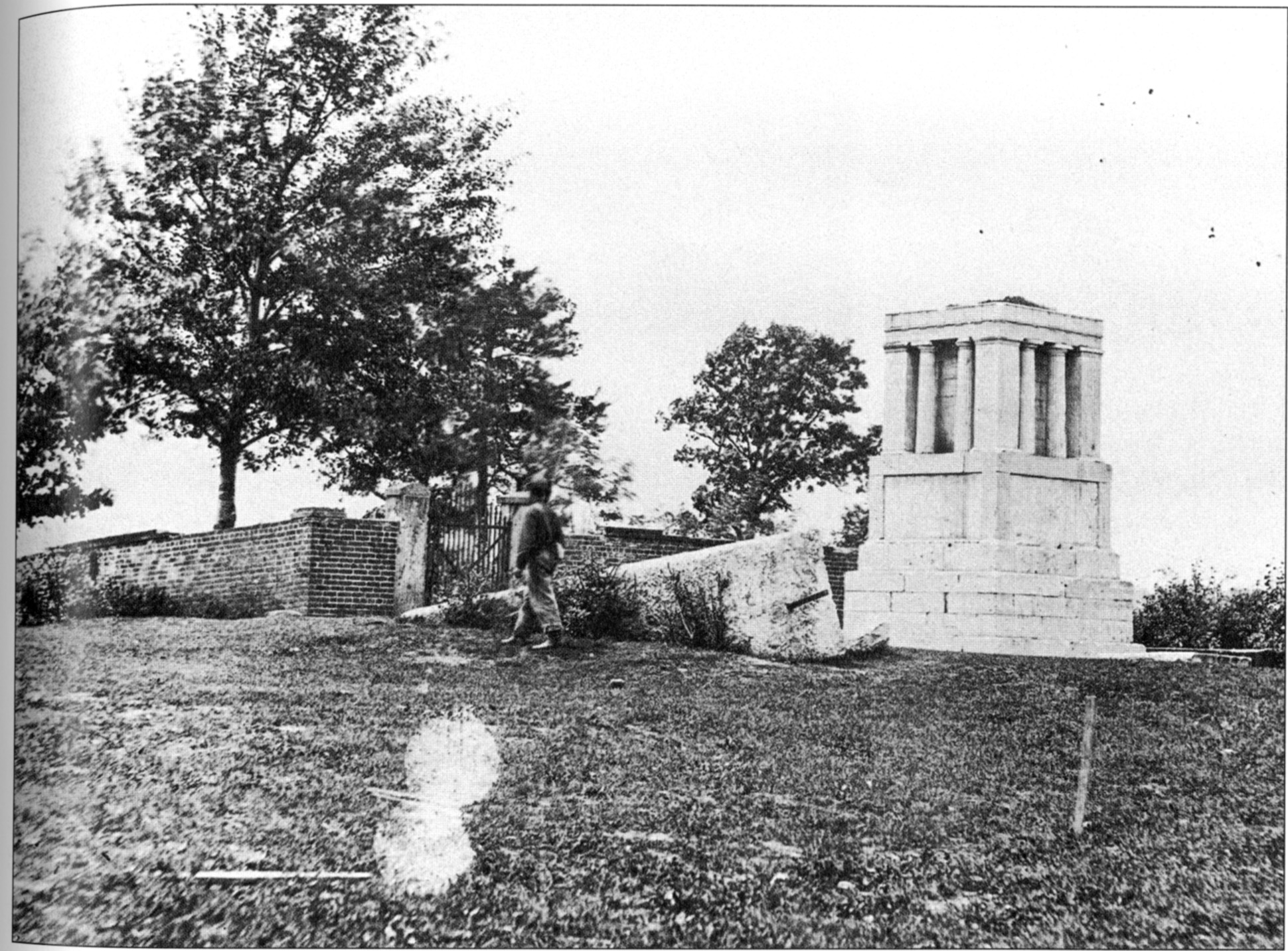 A soldier on guard over the incomplete monument in 1865