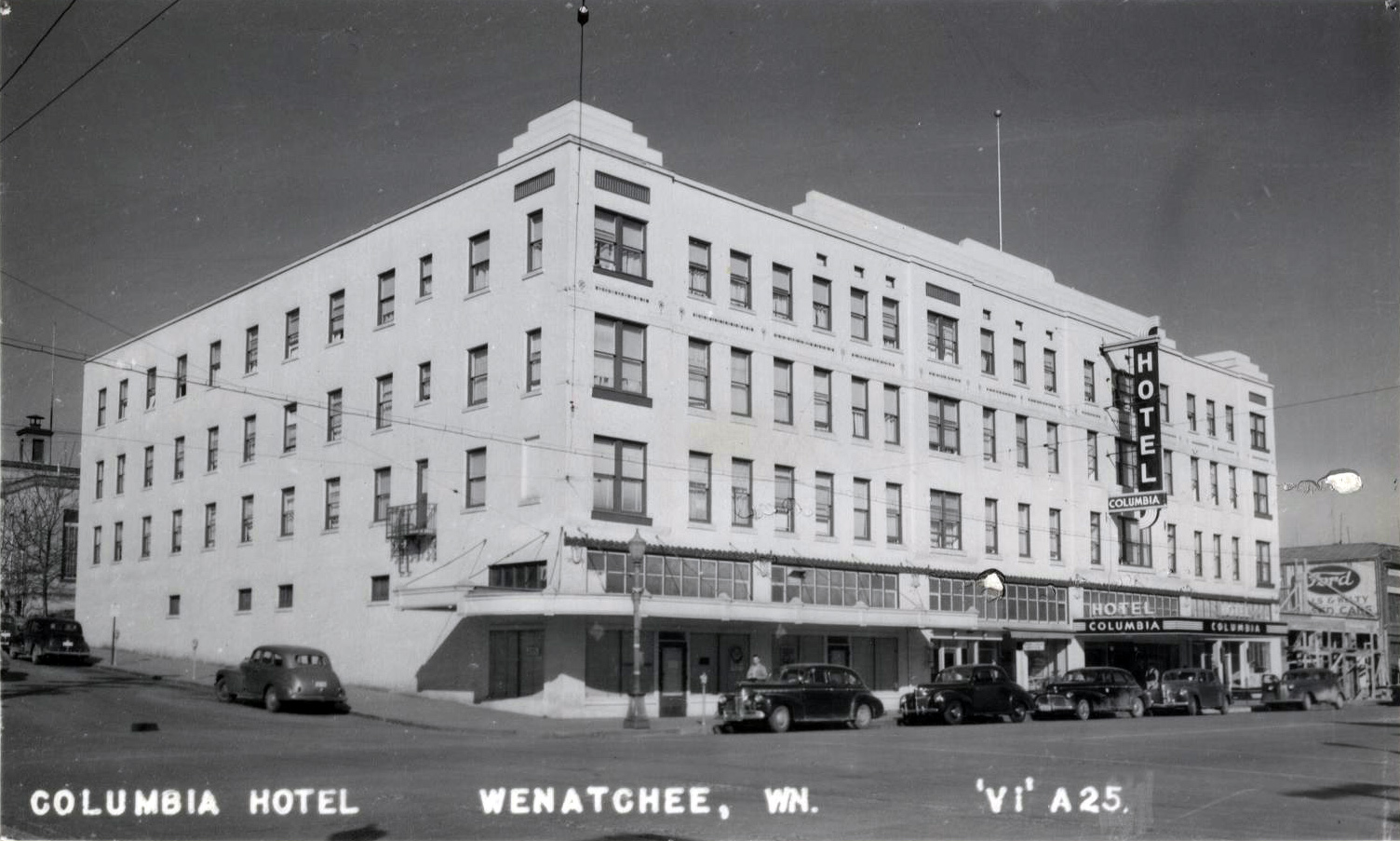 A postcard showing the Columbia Hotel at 130 South Wenatchee Avenue