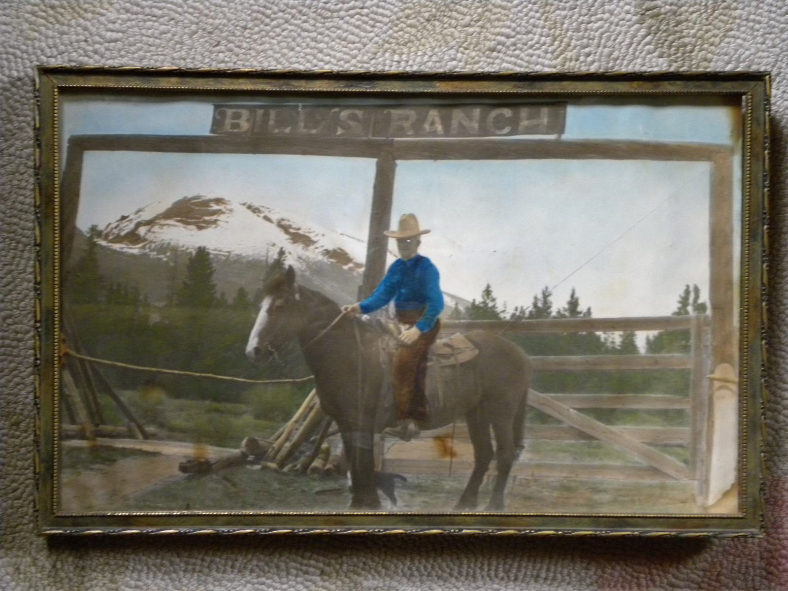 An antique framed photo of Bill Thomas on his horse in front of the Bill's Ranch sign.