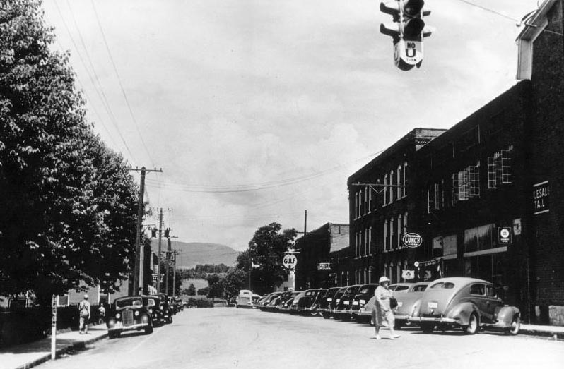 This image offers a view of Wenonah St. in 1940. St. Elizabeth's Hospital building is the tallest building in the image.