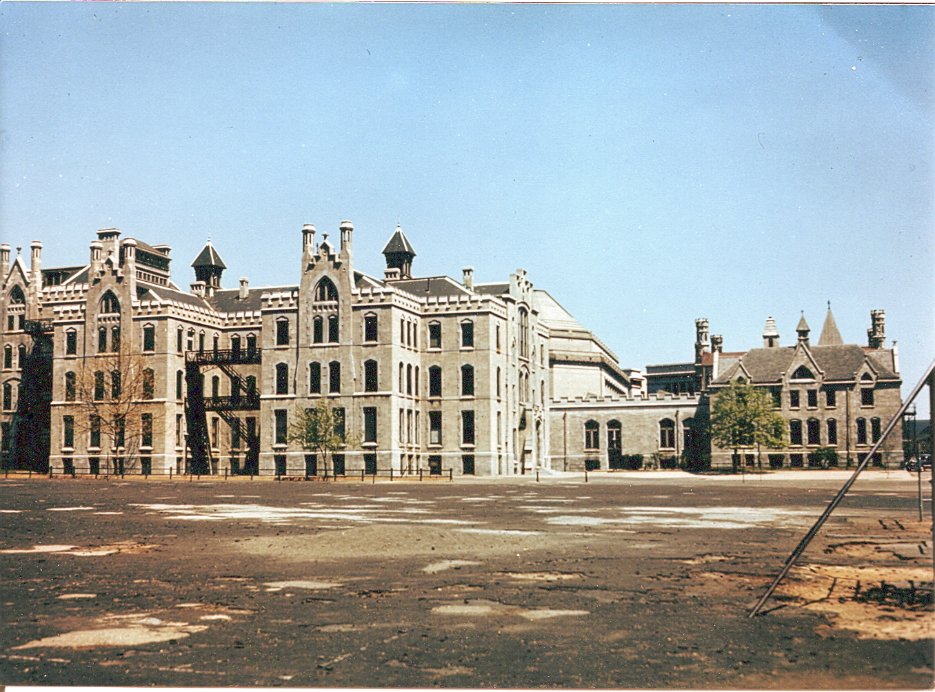 Color photo of Good Friends Building and rear structure of Lafayette Hall before 1960 demolition.