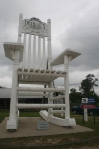 The original 35' tall Magnolia Rocker stands tall in front of the Dedeaux Family Furniture Factory on Canal Road