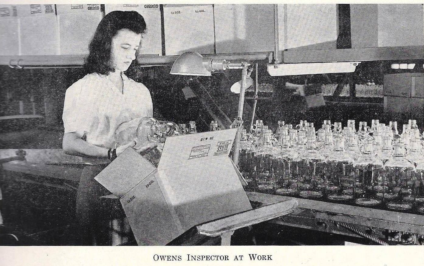 A worker inspects the bottles