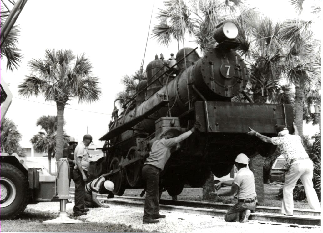 Locomotive #7 being lowered into position at Pablo Historical Park on April 14, 1982. The crews were from B.B.McCormick & Sons and M.C. Moody & Sons.