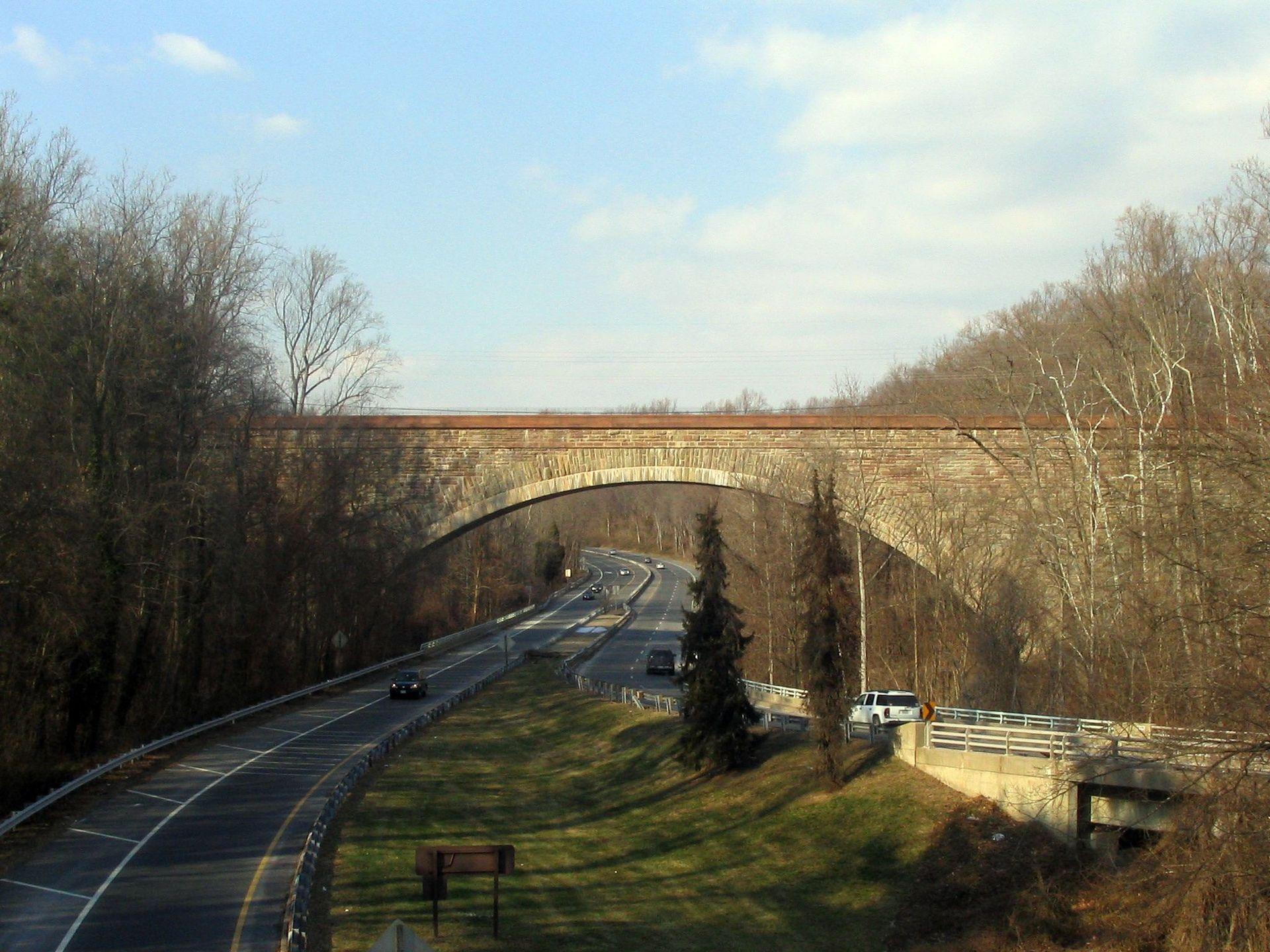 The union arch bridge carries the Washington Aqueduct across Cabin John Creek