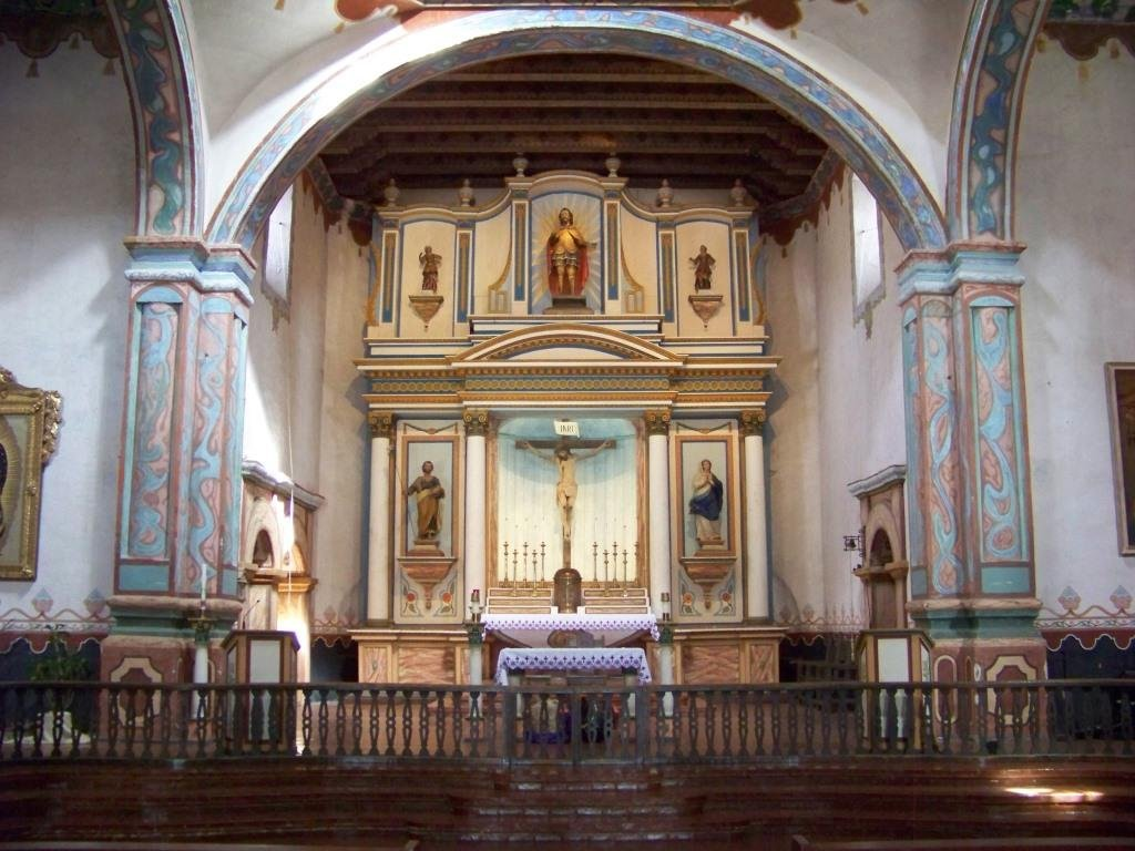 The present-day restored church interior. San Luis Rey features the only surviving cruciform (cross-shaped) structure among the missions, as many original mission churches suffered from repeated earthquakes and had to be rebuilt in the 1800s.