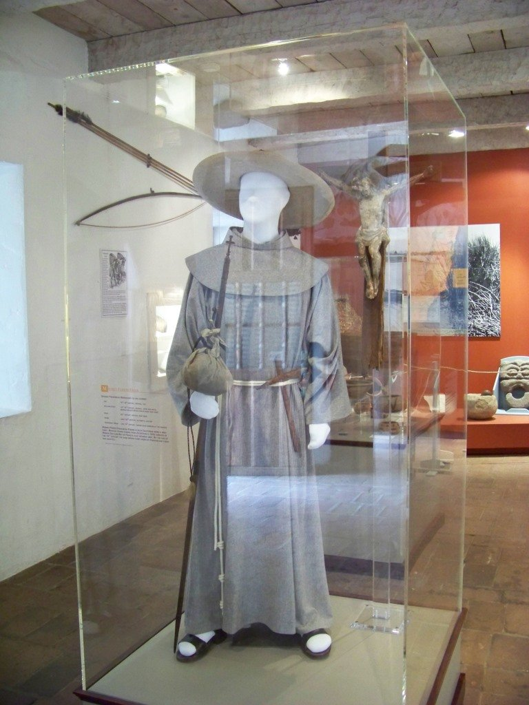 Museum exhibits detail mission life. The garb of one of the Franciscan friars is displayed here, which starkly contrasted with the minimal clothing of the tribes native to California. Courtesy of Mission San Luis Rey.