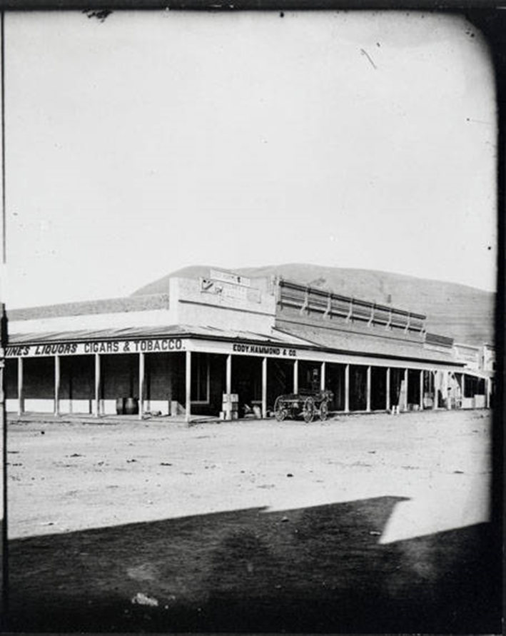 View of Eddy, Hammond & Company Store in Missoula, Montana. Store later called Missoula Mercantile about 1885. Mount Jumbo partially visible in the background. Courtesy of Mtmemory.org.